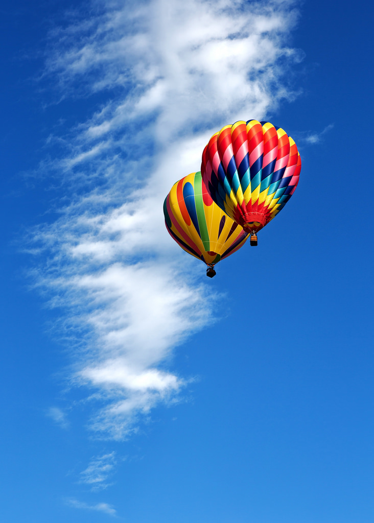 Two Balloons and Blue Sky