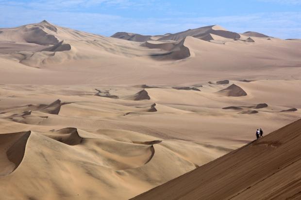 Walking Down Huacachina Dunes