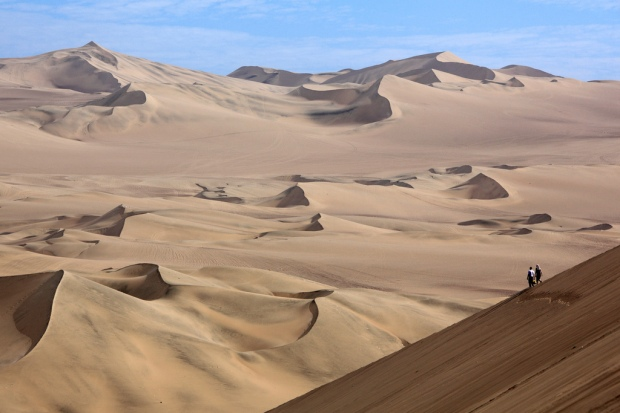 Walking Down Huacachina Dunes