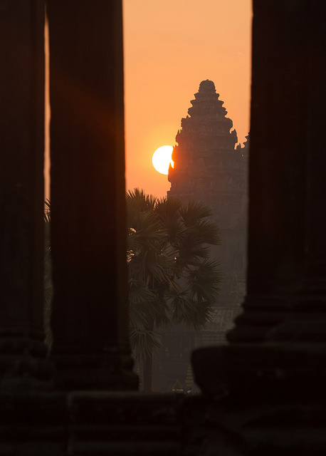 Hazy Angkor Sunrise through Library Pillars