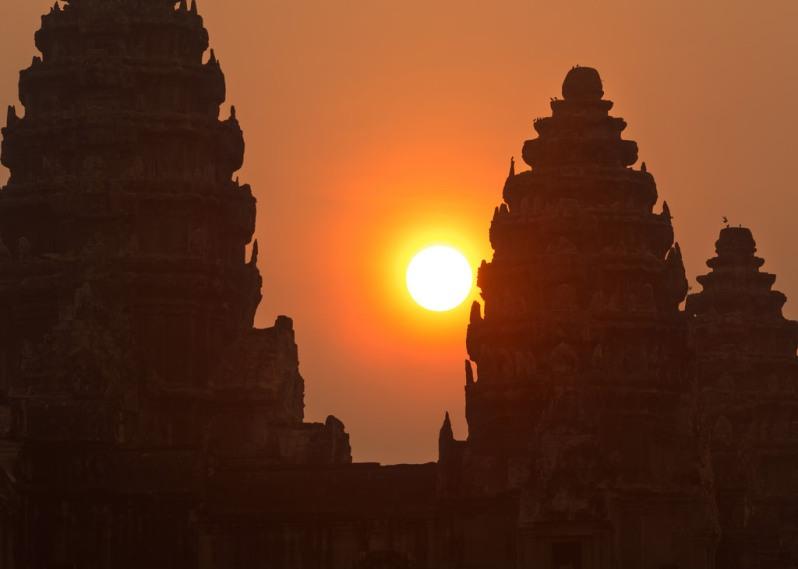 Sun Behind Angkor Wat Towers