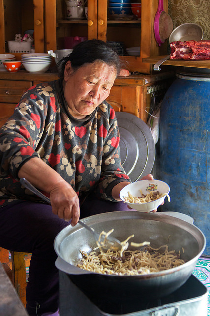 Grandmother Serving Lunch