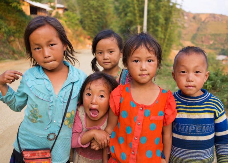 Group of Kids Near Ta Van